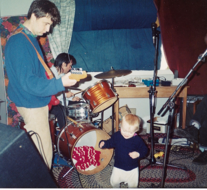 Tom (one year old) dances to Sneaky Feelings: the rug in 1992.