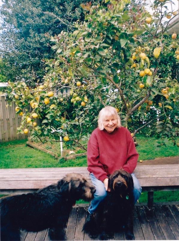 Sue in her back garden with chocolate wheaten terriers Jessie and Lucy.